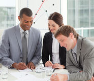 Smiling business people at a gathering Royalty Free Stock Photo