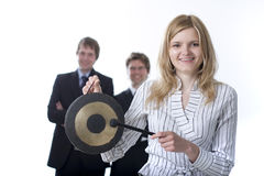 Smiling business people with a gong Royalty Free Stock Images