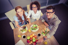 Smiling business people having brunch Royalty Free Stock Images