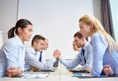 Smiling business people having conflict in office Royalty Free Stock Photography