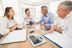 Smiling business people having a meeting Royalty Free Stock Photos