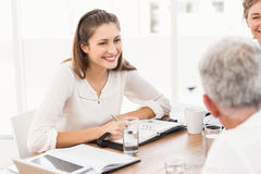 Smiling business people having a meeting Stock Images