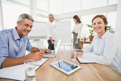 Smiling business people having a meeting Stock Photo
