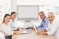 Smiling business people having a meeting Royalty Free Stock Photography