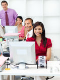 Smiling business people with headset on working. In the office Royalty Free Stock Photos