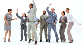 Smiling business people jumping Stock Photo
