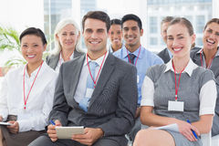 Smiling business people looking at camera during meeting Stock Photo