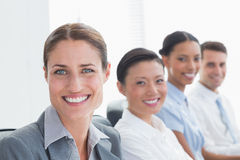 Smiling business people looking at camera Royalty Free Stock Photo
