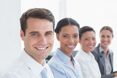 Smiling business people looking at camera Stock Photo