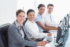 Smiling business people looking at camera Royalty Free Stock Image