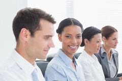 Smiling business people looking at camera Royalty Free Stock Photography