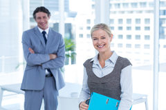 Smiling business people looking at camera Stock Images