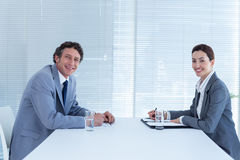 Smiling business people looking at camera Stock Photography
