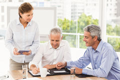 Smiling business people making an arrangement Stock Photos