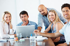Smiling business people at meeting in office Royalty Free Stock Images