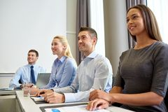 Smiling business people meeting in office Royalty Free Stock Image