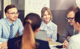 Smiling business people meeting in office royalty free stock photography