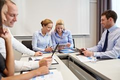 Smiling business people meeting in office Royalty Free Stock Images