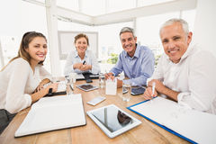 Smiling business people during a meeting Stock Image