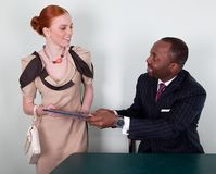Smiling business people negotiating Stock Image