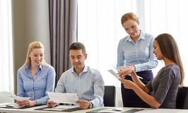 Smiling business people with papers in office Royalty Free Stock Photography