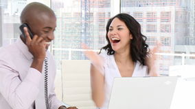 Smiling business people on phone. In the office stock footage