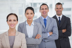 Smiling business people posing crossing arms Stock Image