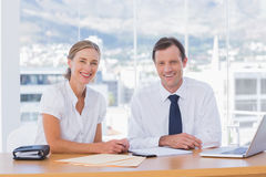 Smiling business people posing together Stock Photos