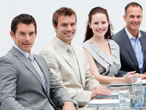 Smiling business people at a presentation Royalty Free Stock Images