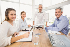 Smiling business people during a presentation Stock Photos