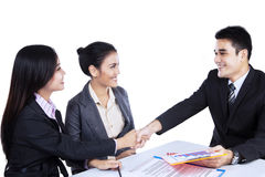 Smiling business people shaking hands Royalty Free Stock Photo