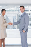 Smiling business people shaking hands Royalty Free Stock Images