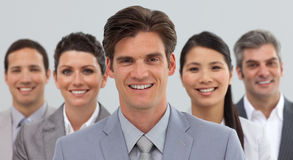 Smiling business people showing diversity Stock Photos