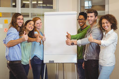 Smiling business people showing thumbs up Royalty Free Stock Image