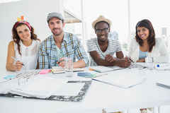 Smiling business people sitting and posing Stock Images