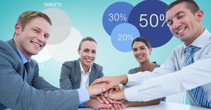 Smiling business people stacking hands. Digital composite of Smiling business people stacking hands Stock Photo