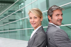 Smiling business people standing in hallway Stock Photos