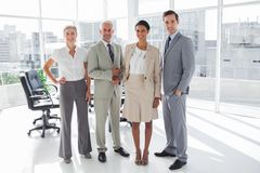 Smiling business people standing in line Royalty Free Stock Images