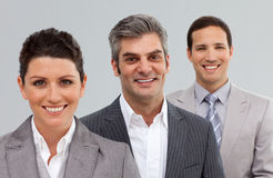 Smiling business people standing together Royalty Free Stock Image