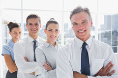 Smiling business people standing together in line Stock Photography