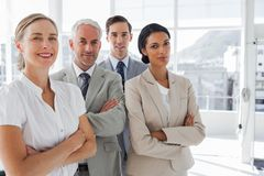 Smiling business people standing together Royalty Free Stock Photos
