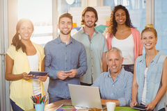 Smiling business people with technologies in meeting room Royalty Free Stock Photos