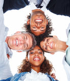 Smiling business people with their heads together Royalty Free Stock Images
