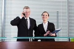 Smiling business people during their work Royalty Free Stock Photos