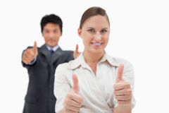 Smiling business people with the thumbs up Royalty Free Stock Photos