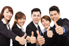 Smiling business people with thumbs up Stock Images