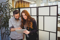 Smiling business people using digital tablet Royalty Free Stock Photography