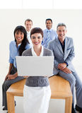 Smiling business people using a laptop Royalty Free Stock Image