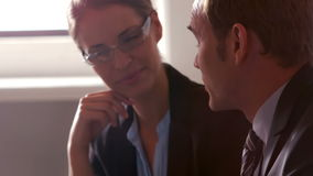 Smiling business people using tablet. On sofa stock video footage