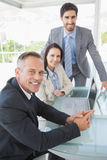 Smiling business people at work Royalty Free Stock Photos